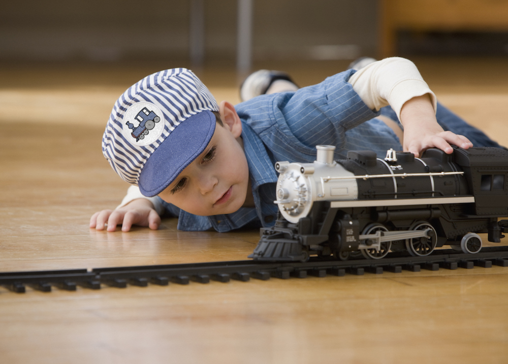 Kid playing with train